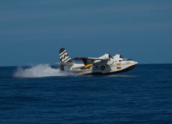 The Billabong seaplane just as it touches the water before bouncing up again. Photo Lindsey Hoshaw