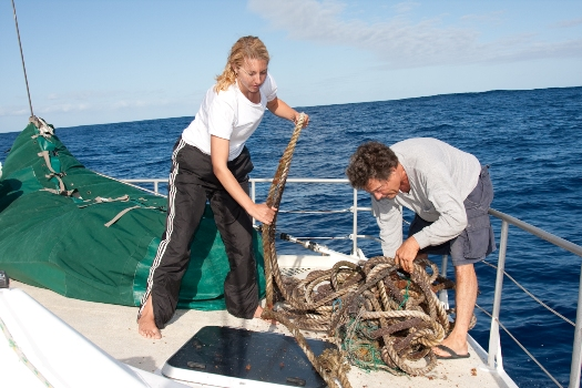 Moore and I trying to unravel an 80lb rope we pulled on board (Photo by Jeff Ernst)