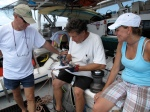 Captain Moore drawing a diagram of how to put up the spinnaker (a special sail designed for use when sailing downwind)