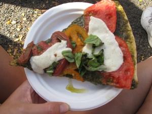 Fresh pizza napoletana with pesto, buffalo mozzarella, tomatoes and basil, some of the best I've ever had