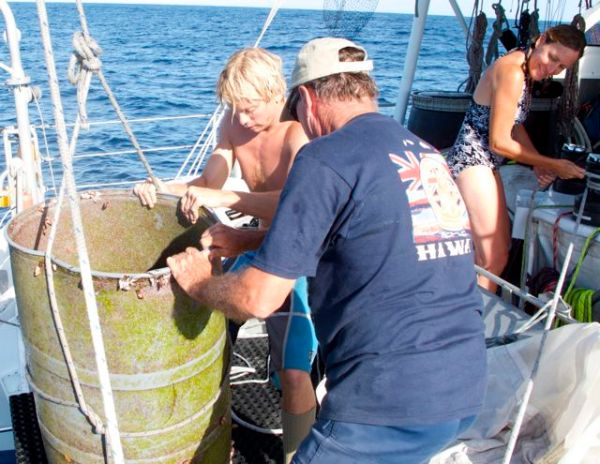 Jeff and Bill hauling a plastic barrel full of fish on board, a first for the crew. Photo by Lindsey Hoshaw