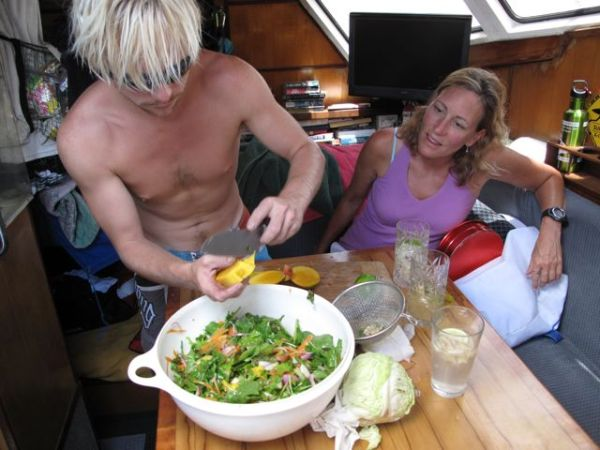 Jeff making a salad and Bonnie looking on. We made a lot of salads the first week while we still had plenty of fresh produce. Photo by Lindsey Hoshaw