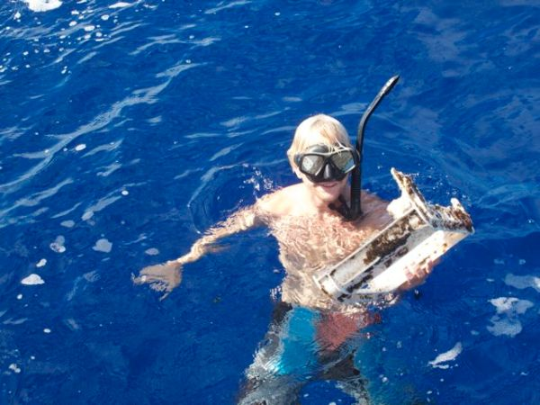 Jeff swam out this morning and retrieved part of a plastic packing crate. Photo Lindsey Hoshaw