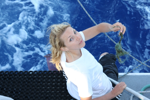Me with string, caption: A piece of fishing line I caught off the stern with a hand net. Photo Jeff Ernst