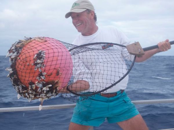 Bill catches a barnacle-covered buoy